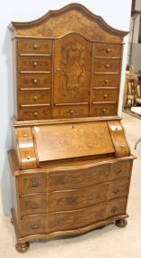 Italian Secretary with Exotic Wood Veneers, Twenty Paper Lined Drawers and a  Fold Down Desk with a Upper Fabric Lined Cabinet
