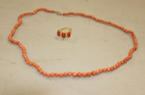 A 14K Yellow Gold and Coral Italian Ring with a Coral Bead Necklace with 14K Yellow Gold Clasp