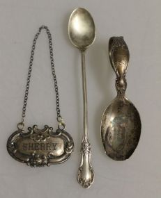 Sterling Silver Sherry Liquor Tag, a International Sterling Baby Spoon, a Sterling Silver Baby Spoon With a Etched Bowl of Cats