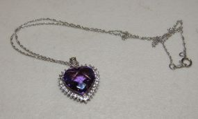 Sterling Silver Multi Faceted Purple Stone Pendant in Heart Shape with Clear Surrounding Stones