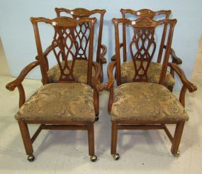 Four Chippendale Style Chairs on Castors with Upholstered Seats