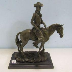 Bronze Cowboy Riding Horse Statue