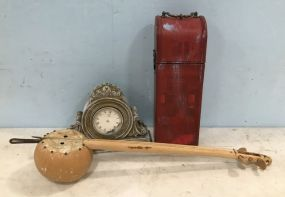 Modern Resin Mantle Clock, Red Painted Container, and Tribal Instrument