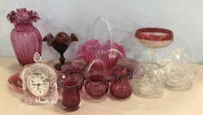 Group of Red, Pink, and Clear Glass Decor