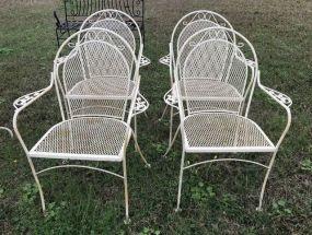 Four White Wrought Iron Patio Chairs