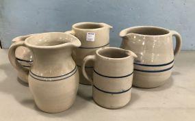 Five Blue Label Stoneware Pitchers