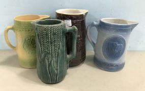 Four Glaze Stoneware Pitchers