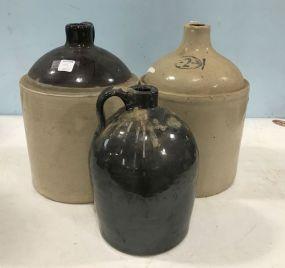 Three Stoneware Crock Jugs