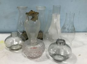 Group of Hurricane Shades and Oil Containers