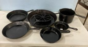 Group of Cast Iron Skillets and Pot