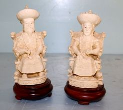 Two Faux Ivory Carved Figurines