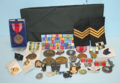 Large Group of Military Pins, Ribbons, Medals, and a Green Army Cap