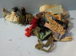 Three Mini Dolls and Assortment of Doll Clothes