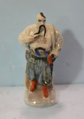 Lusterware Figurine of Warrior with Pipe