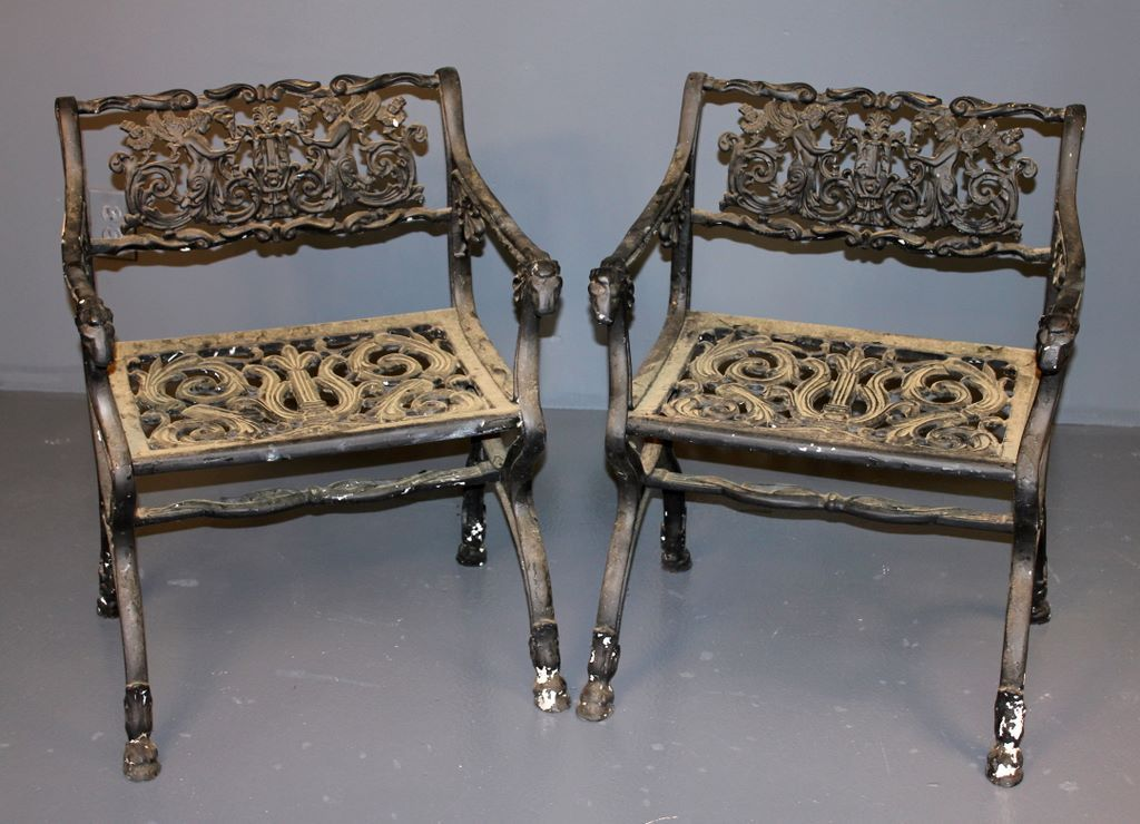 Pair of vintage iron arm chairs