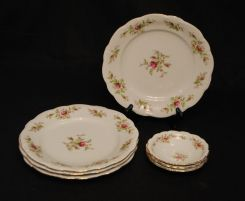Porcelain Stacking Dishes and Blue Vase
